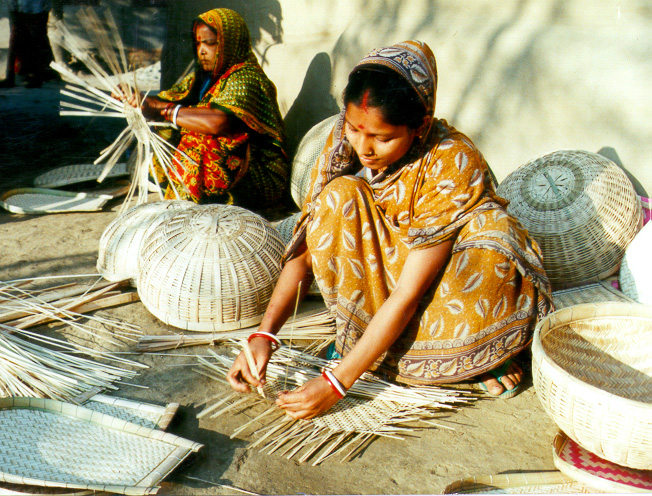 Bangladeshi women making baskets