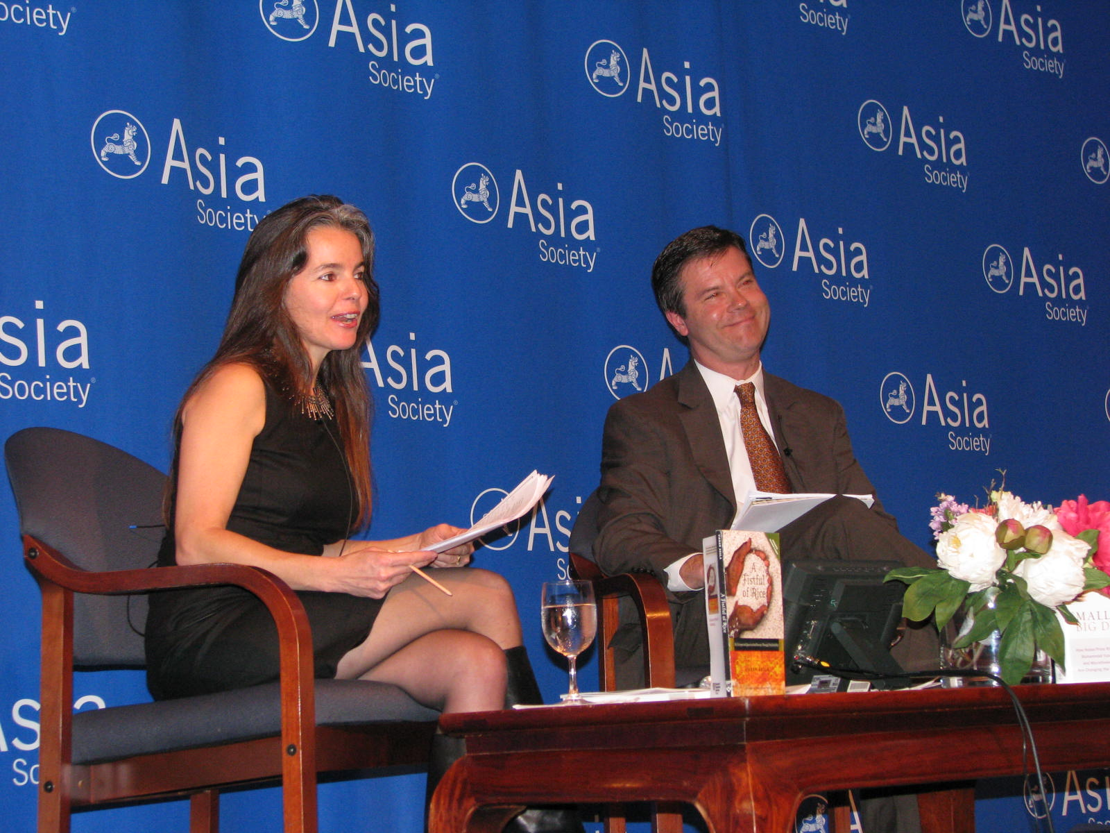 Debate moderator Niki Armacost, co-founder of Arc Finance, with Alex Counts, at his October 2010 debate with Vikram Akula, chair and founder of SKS, at the Asia Society.