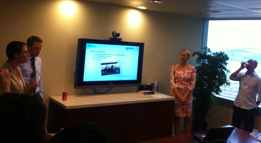 Shannon Maynard (left) meets with Grameen Foundation staff in Hong Kong.