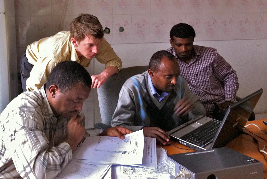 David Washer (center) spent a week meeting clients and lending his skills in finance to Eshet, an Ethiopian MFI, as part of BwB's Financial Modeling Reserve Corps.