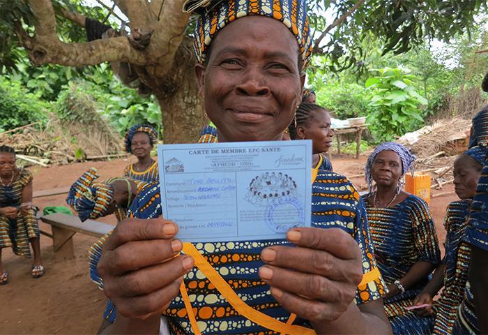 Proud Health Savings Group member show us her membership card.